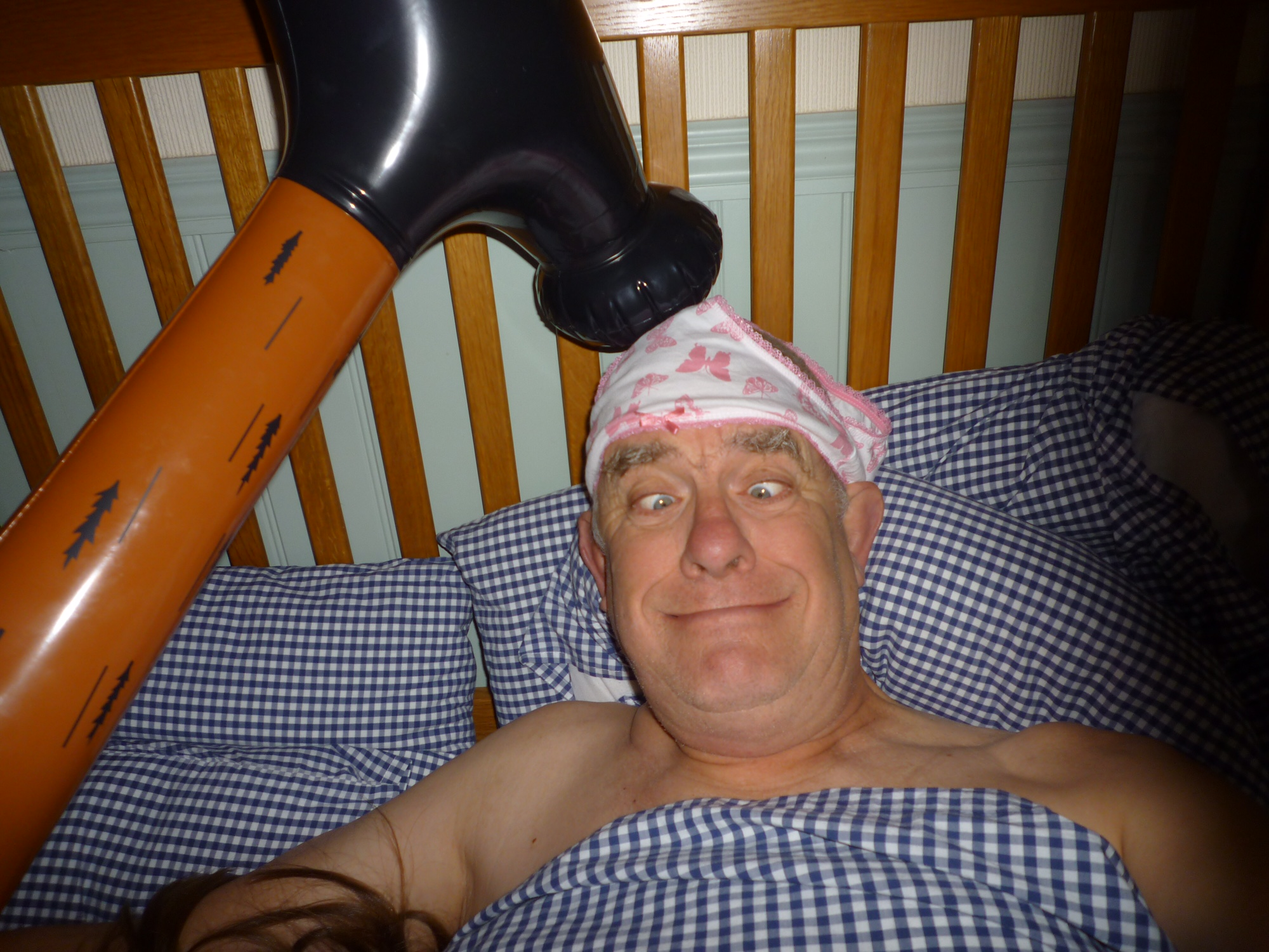 GAD. Generalised Anxiety Disorder: Bobby in bed, with bandaged head and an inflatable hammer over it!